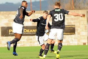 Iain Davidson (centre) after scoring his equaliser against East Fife - Fife Photo Agency