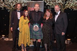 David Smith, Managing Partner of category sponsor Henderson Loggie, and host Fred MacAulay with the Byron team - Ronnie Marshall, Megan Paterson and Jill Graham. Pic: Kenny Smith.