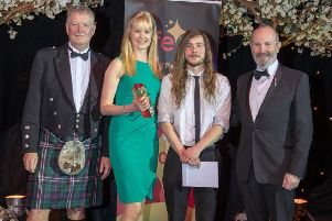 Best School Partnership, sponsored by BAE Systems, presented by Dave Rollo to Claire Reid, Education Manager and Calum Murray, Education Officer at The Ecology Centre. Pic: Kenny Smith.