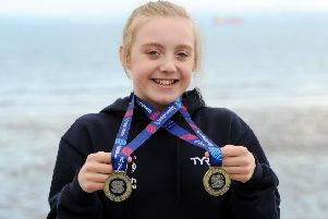 Erin Taylor shows off her two gold medals (Pic by Fife Photo Agency)