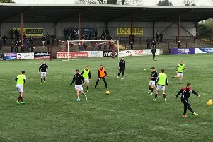 The teams warm-up before kick-off.