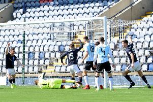 Dave McKay's header sneaks over the line for Raith's opener against Stranraer on Saturday. Pic: Fife Photo Agency