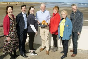 Sponsors and supporters of this years event pictured against the backdrop of West Sands Beach.