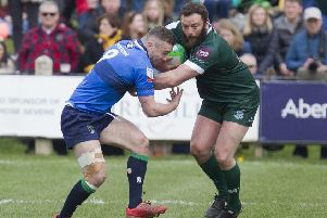 Bruce McNeil of Hawick wins this tussle for the ball against Boroughmuir at last weekend's Melrose 7s (picture by Bill McBurnie).