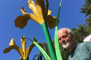 Malcolm Robertson with one of his most famous creations -  Giant Irises.