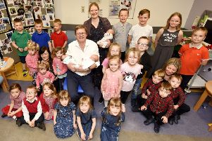 Graham Tydeman surrounded by the  triplets he helped to deliver. Pic:  Fife Photo Agency.