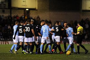 Raith and Forfar players square up after a poor challenge on Ross Matthews.