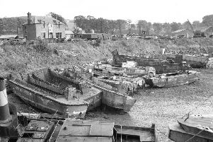 St David's harbour in Burntisland Fife  Old landing craft from World War II waiting for breaking up.