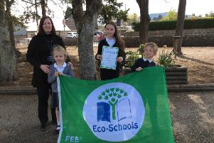 Laura Obernay with pupils and the Eco flag