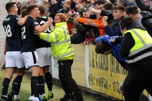 Raith players celebrate Kevin Nisbet's penalty kick with the travelling fans. Pic: Fife Photo Agency