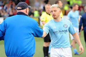 Raith Rovers boss John McGlynn shakes hands with an angry John Baird at the end of Saturday's play-off victory over Forfar. Pic: Fife Photo Agency