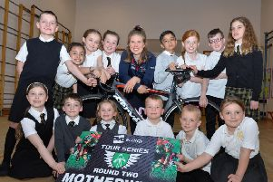 Cyclist Rhona Callander with pupils from Ladywell Primary