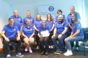 Michelle (front row centre) with volunteers from the  Kirkcaldy-Glenrothes company.