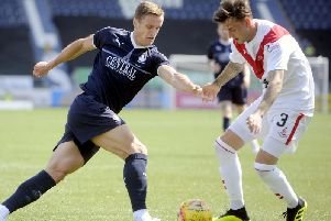 Kieran MacDonald (right) in action for Airdrie against Falkirk. Pic: Michael Gillen