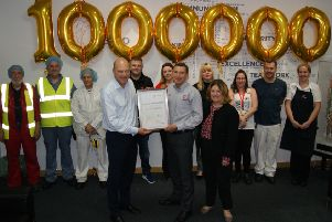 Devro's CEO Rutger Helbing (left) presents a certificate to Scottish operations director Gary Shiels