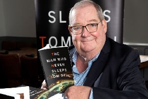 Author Tom Bell with his book The Man Who Never Sleeps.