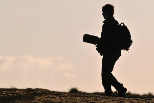 A photographer heads off in search of their next shot (picture: Scottish Natural Heritage)