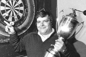 Jocky Wilson in Kirkcaldy with the Embassy Darts World Championship trophy