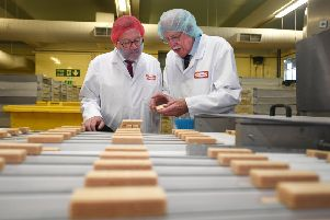 Boyd Tunnock gives 'Scottish Secretary David Mundell a tour of the manufacturing operation