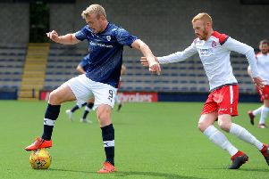 Lewis Allan holds off the attentions of a Spartans defender during Saturday's friendly win at Stark's Park. Pic: Fife Photo Agency