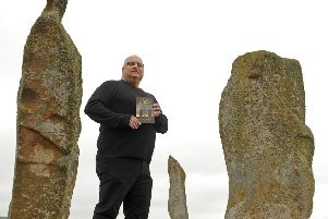 Leonard Low with one of his other books.