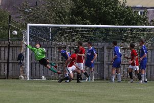 Coldstream's trialist 'keeper punched the ball away.