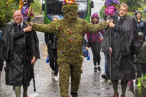 The weather is grim - but nothing stops the Burryman.