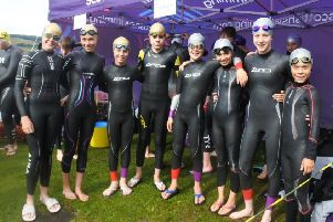 The two relay teams, with medallists Fraser and Daniel third and fourth from the left.