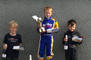 Cameron McPhie (7) wins Scottish Bambino Championship race in Golspie