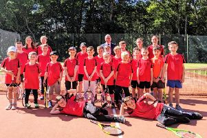 Kirkcaldy Lawn Tennis Club teams are pictured with Neil Dibble of sponsors Specsavers Kirkcaldy