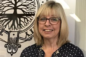 At the helm...Alison Murray is proud to lead a dedicated team of volunteers who help the society's 750 members scour the archives for family history.