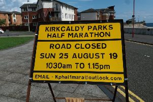 138 traffic signs informing Kirkcaldy residents of road closures in their area while the marathon is on have been erected throughout the town. Pictured is one at the entrance to Williamson's Quay at the harbour.
