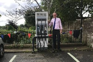 John Lamont MP at an electric car charging point in Coldstream, now he wants to see more all over the Borders
