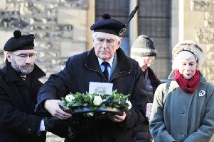 Ranald MacDonnell, current chieftain of the MacDonnells of Glengarry, prepares to lay a wreath at the Trinity Church tomb of his ancestor.  The ceremony took place in January last year, and a plaque was installed to inform visitors of the terrible historic events which once happened in and around Falkirk.