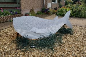 A whale scarecrow in Kinghorn commemorates the one who died in the Forth through being entangled in plastic netting.