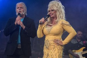 Andy Crust and Sarah Jayne impersonating Kenny Rogers and Dolly Parton.
