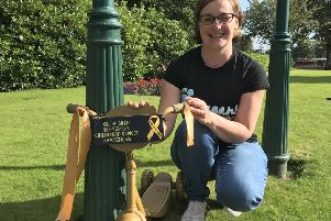 Kirkcaldy mum Kelly Clarkson with one of the spray-painted bikes for the Glow Gold September Campaign which raises awareness of childhood cancer.