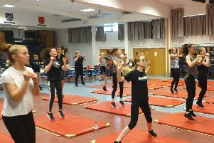 The pupils and parents taking part in the 'insanity workout' sessions.