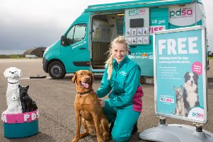 PDSA Vet Nurse Louise Chapman with Zak at the PetWise van.