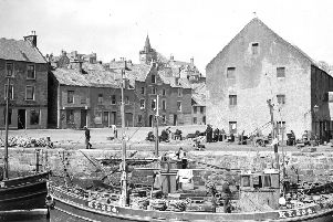 Fishing boats and fishermen in  Pittenweem Harbour