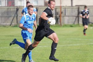 Stuart Cargill (left) puts a Crossgates defender under pressure. Pic: George Wallace