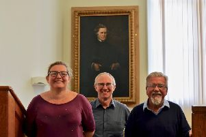 Louise McEwan of the East Neuk Centre, Gavin Grant of Fife Cultural Trust, and Glenn Jones of the Anstruther and Kilrenny Burgh Collection, with the portrait of Thomas Black