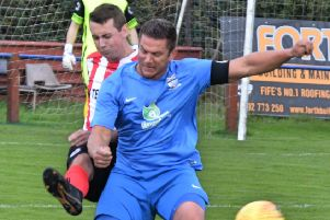 Lee Bryce battles with a Larkhall defender.