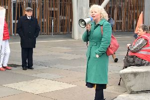Claire Baker speaks at the rally.