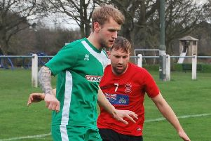 Jamie Mackie (in red) bagged a hat-trick for Tayport.
