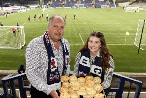 John Simpson, from BWS Catering, along with daughter Brooke, promote the Pie for a Player fundraiser at Stark's Park. Pic: Fife Photo Agency