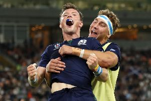 George Horne celebrates scoring during Scotland's crushing win over Russia. (Photo by Mike Hewitt/Getty Images)