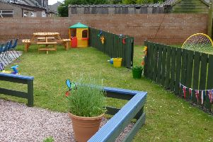 Land next to Salvation Army hall in Lochgelly transformed into a community garden by people on community payback orders.