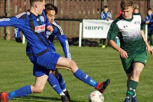 Burntisland's Sandy Strang in the thick of the action.
