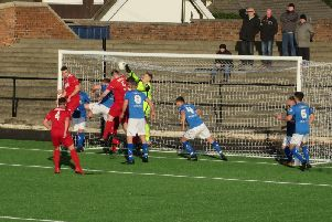 A crowded Bo'ness box as YM attack from a corner.